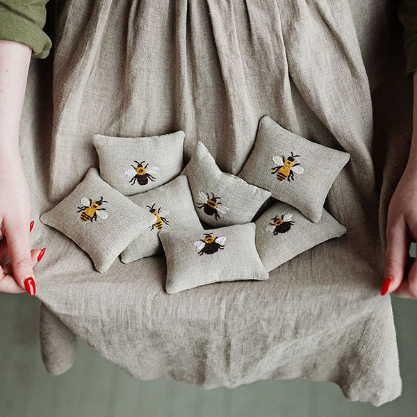 embroidered bee lavender satchets by all the beautiful linen