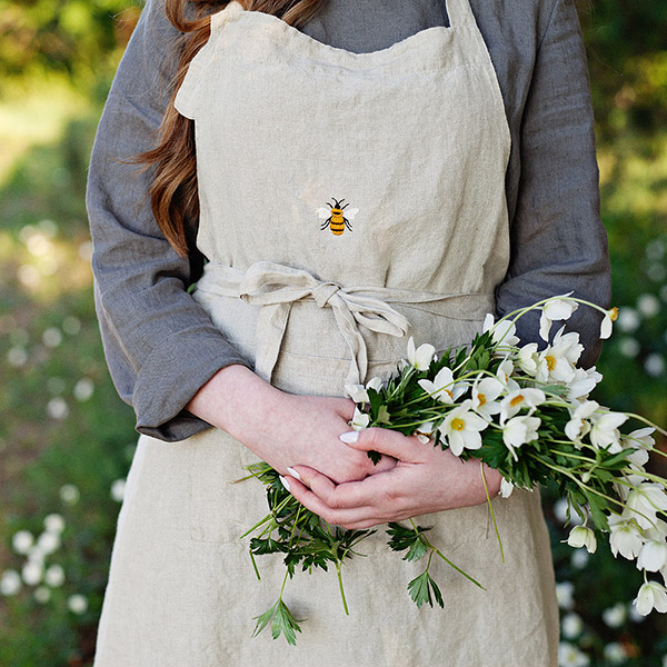 hand embroidered bee linen apron by all the beautiful linen