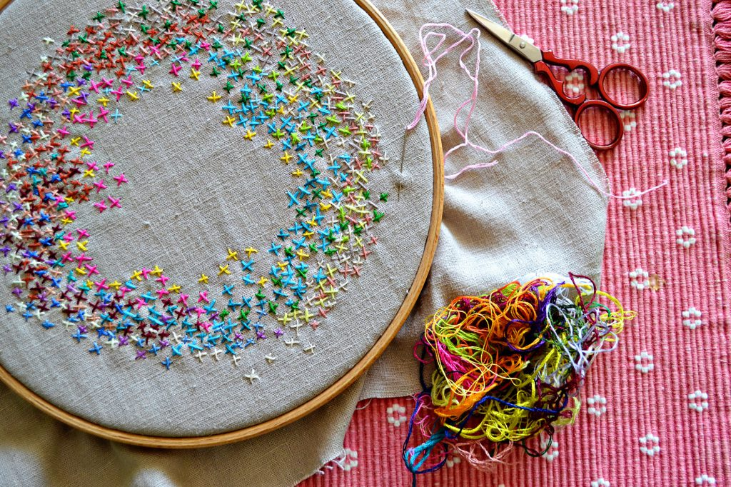 cross stitch project with left-over threads